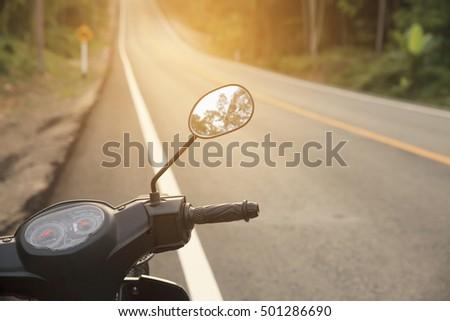 Handlebars of motorcycle on sunset. #501286690