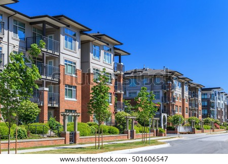 Modern apartment buildings in Richmond, British Columbia, Canada. Royalty-Free Stock Photo #501606547