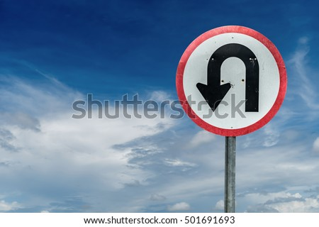 U turn sign on white cloud and blue sky background with clipping path #501691693