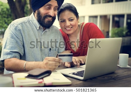 Indian Couple Using Device Concept #501821365