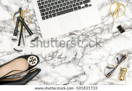 Notebook, shoes, office supplies, feminine business woman accessories on bright marble table background. Fashion shopping flat lay for blogger social media