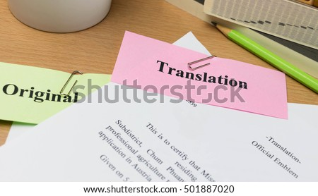 translation paper on wooden table with books and mug