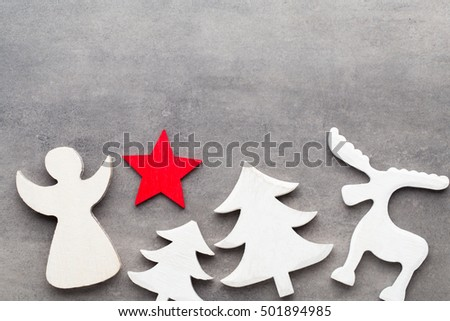 Christmas background. White tree decorations on a gray background. Deer. Spruce. Star. Angel. #501894985