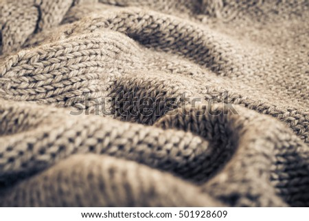 Knitted fabric wool texture close up as a background #501928609