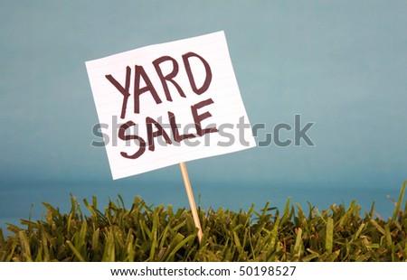 yard sale sign in grass