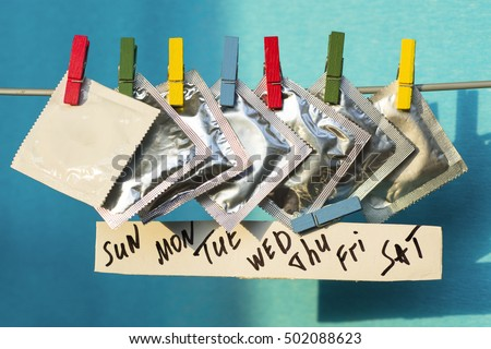 condoms on colorful clothespins. seven days of the week - sexweek, space for text. selective focus image #502088623