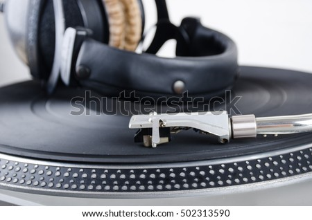 close up vintage turn table with Headphone on Wooden floor for template music #502313590