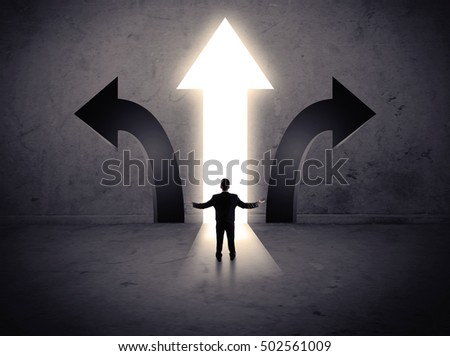 A businessman in doubt, having to choose between three different choices indicated by arrows pointing in opposite direction concept #502561009