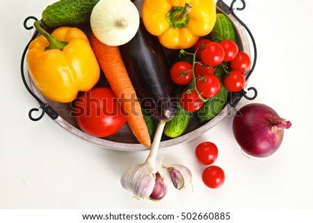 Pile of organic vegetables on a rustic wooden table #502660885