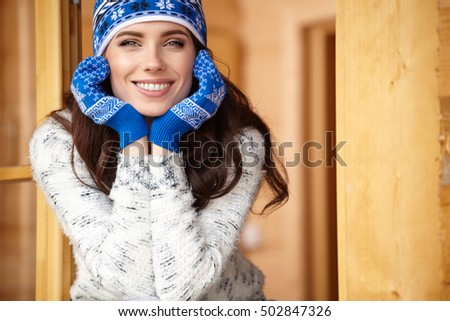 woman resting after a winter sports on the terrace of the house #502847326