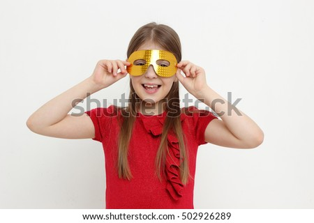 Little girl and mask #502926289