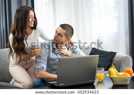 Young couple with laptop at home. #502934623