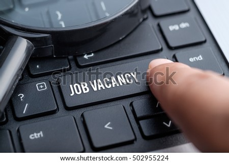 Job Vacancy, computer keyboard, magnifying glass. Human resource business concept. Royalty-Free Stock Photo #502955224