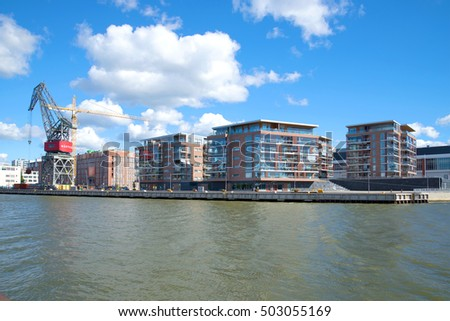 TURKU, FINLAND - AUGUST 27, 2016: Modern residential complex on the embankment of the river Aura #503055169