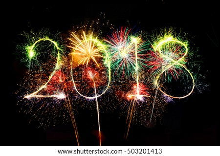 HAPPY NEW YEAR 2018 from colorful sparkle on black background Fireworks light up the sky,New Year celebration fireworks
