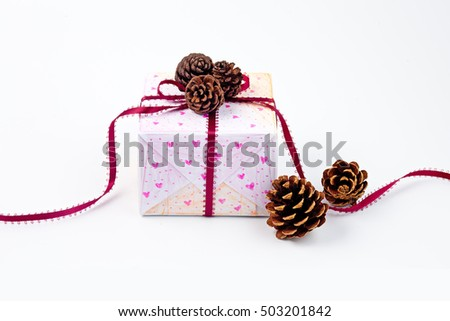 Festive gift box with ribbon bow on white background #503201842