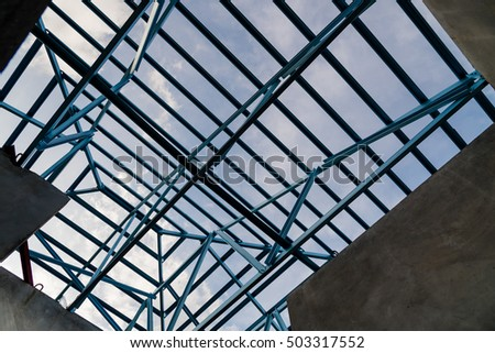 Structure of steel roof frame for building construction on sky background. #503317552