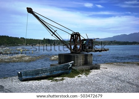 On the old quay, Kaikorua, New Zealand stand this hand operated crane #503472679