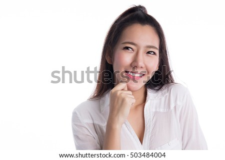 Beautiful asian woman thinking, isolated on blue background #503484004