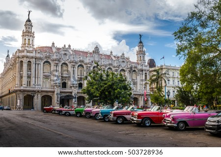 HAVANA, CUBA - OCTOBER 8, 2016 : Cuban colorful vintage cars in front of the Gran Teatro #503728936