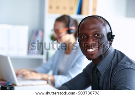 Portrait of an African American young business man with headset #503730796