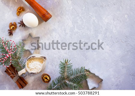 Ingredients for Christmas baking - spices, flour, egg, powdered sugar and shape cookie cutters. Seasonal, food background. #503788291