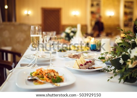 a glass of champagne at the wedding table #503929150