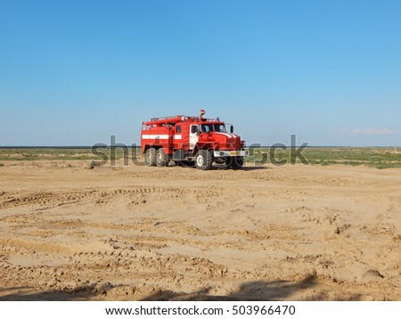 Firefighter car on desert background. #503966470