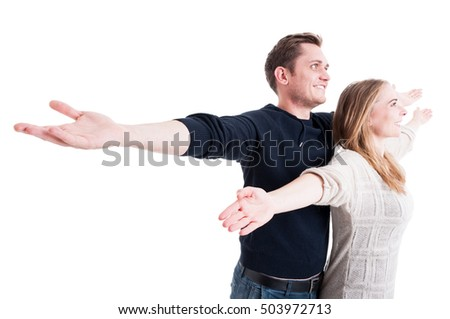 Handsome couple posing like being on Titanic isolated on white background with copy text space Royalty-Free Stock Photo #503972713
