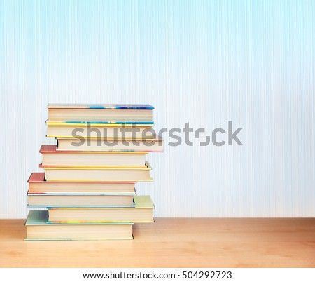 Colorful books on a wooden table. #504292723