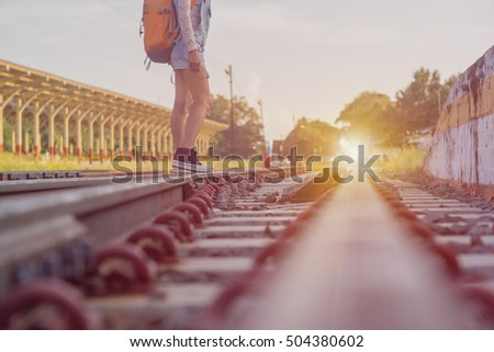 woman hiker with a backpack going on the railway. concept lifestyle #504380602