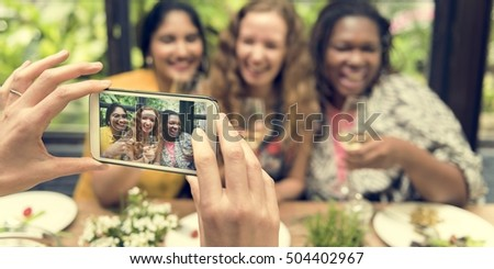 Women Taking Pictures Device Concept