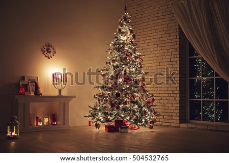 Feast of Christmas. Beautifully decorated house with a Christmas tree ipodarkami underneath