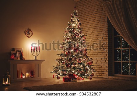 Feast of Christmas. Beautifully decorated house with a Christmas tree ipodarkami underneath #504532807