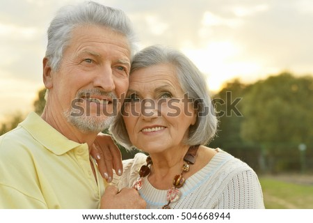 Mature couple in spring park #504668944