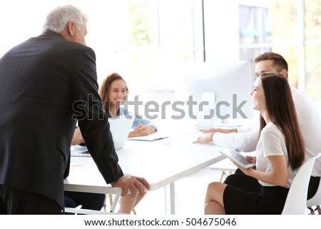 Business training concept. Colleagues at an office meeting #504675046