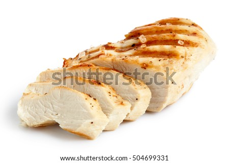 Partially sliced grilled chicken breast with black pepper and rock salt isolated on white. Royalty-Free Stock Photo #504699331
