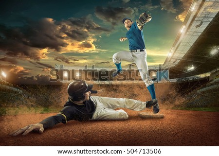 Baseball players in action on the stadium. #504713506