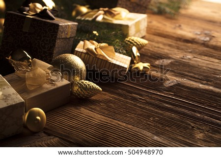 Christmas theme. Presents on a wooden table. Golden and brownish aesthetics. #504948970