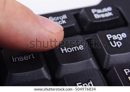 Male finger pressing Home button #504976834