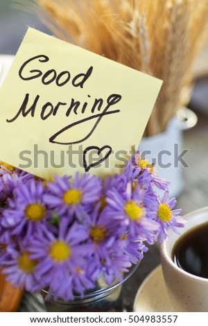 sunny morning breakfast - cup of coffee with bouquet of flowers and and chocolate brownies, wheat sheaf in a decorative bucket. note text good morning,  soft focus insta filter image.