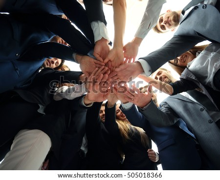 Large successfull business team showing unity with their hands t #505018366
