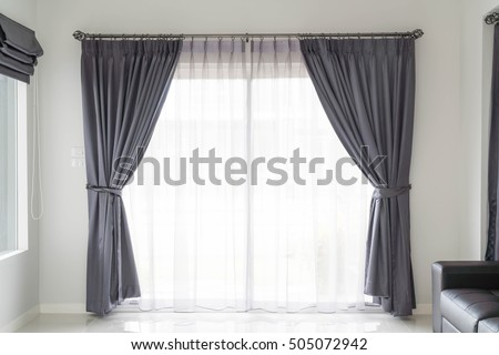 Curtain interior decoration in living room with sunlight Royalty-Free Stock Photo #505072942