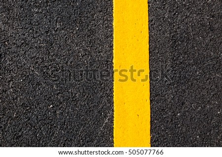 Yellow line on new asphalt detail,Street with yellow line texture #505077766