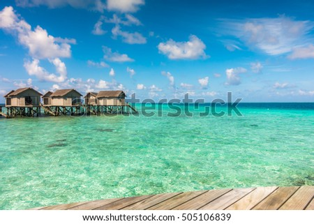 Beautiful tropical Maldives resort hotel with beach and blue water #505106839