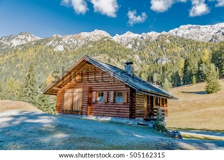 landscape with snow in the forest in the national park of the Dolomites in South Tyrol Italy Odle with sky and autumn colors in the forest roads and mountain streams #505162315