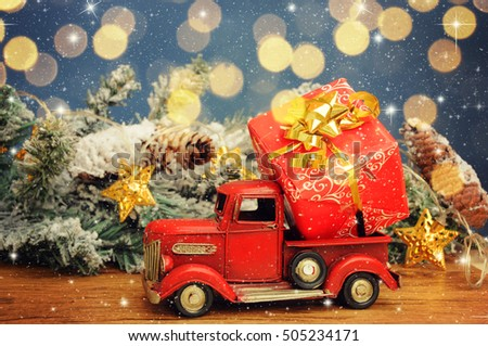 Christmas background. Pickup with christmas gift