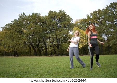 Two young women hawing fun in park #505252444