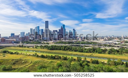 Panoramic aerial view Downtown with Interstate 10, 45 and Gulf freeway intersection. Massive highway, stack interchange, viaduct and elevated road junction overpass from Northeast Houston, Texas, USA. #505258525