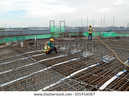 MALACCA, MALAYSIA -SEPTEMBER 24, 2016: Construction workers fabricating floor slab reinforcement bar at the construction site in Malacca, Malaysia.    #505456087